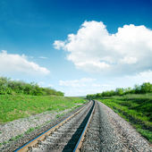 White clouds over railroad — Stock Photo