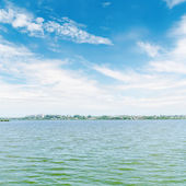 River and blue sky with white clouds — Stock Photo