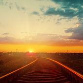 Good orange sunset over railroad to horizon — Stock Photo