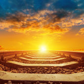 Beautiful orange sunset over railroad close up — Stock Photo