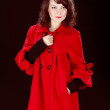 Beautiful young lady wearing red poncho clothes — Stock Photo #10220935