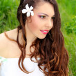 Young woman outdoors portrait. Beautiful face and long curly hea — Stock Photo #10922580