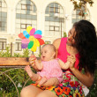 Outdoor portrait of young happy mother playing with child — Stock Photo #12179053