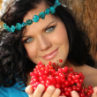 Portrait of beautiful Woman on rest with berry in her hands — Stock Photo
