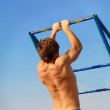 Young bodybuilder training in the gym over blue sky — Stock Photo