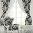 Modern pattern armchair in baroque design interior, black and wh - Stockfoto