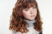 Beauty woman portrait of teen girl with long curly brown hair an — Stock Photo