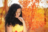 Autumn portrait of beautiful brunette woman model with bright ma — Stock Photo