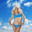Beautiful Model in blue bikini with long curly Blond hair — Stock Photo