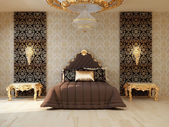 Luxury bedroom with golden furniture in royal interior — Stock Photo