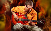 Musician Man playing electronic guitar at bright background — Stock Photo