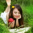 Smiling Young Woman with red Apple reading the book in the Orcha — Stock Photo #13655851