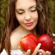 Portrait of Pretty young woman with three red apples. — Stock Photo