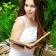 Beautiful woman read book. Nature. Green Garden. — Stock Photo