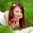 Beautiful Smiling Young Woman with red Apple reading the book in — Stock Photo