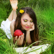 Smiling Young Woman with red Apple reading the book in the Orcha — Stock Photo