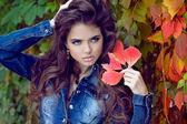 Beautiful elegant woman posing at park, autumn portrait — Stock Photo