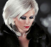 Blond hair styling woman with make up — Stock Photo