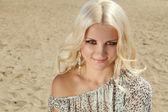 Pretty blond woman on sand beach background — Stock Photo