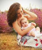 Mother and baby in park, outdoors portrait — Stock Photo