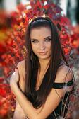 Portrait of beautiful female teen girl in autumn park — Stock Photo