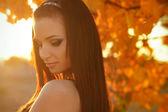 Sunset Autumn young woman portrait. Soft sunny colors — Stock Photo