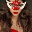 Beautiful Girl in Carnival mask with long curly hair. Masquerade — Stock Photo