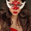 Royalty-Free Stock Photo: Beautiful Girl in Carnival mask with long curly hair. Masquerade