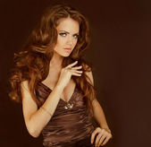 Fashion lady, sensual brunette woman with shiny curly silky hair — Stock Photo