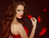 Woman with beauty long curly brown hair and red lips. Fashion wo — Stock Photo