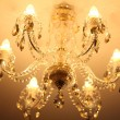 Luxury vintage crystal chandelier on a ceiling in apartment room — Stock Photo