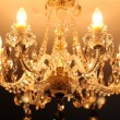 Luxury vintage crystal chandelier on a ceiling in apartment room - Zdjęcie stockowe