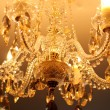 Vintage crystal chandelier in a room — Stock Photo