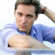 Relaxing young handsome man, outdoor portrait — Stock Photo
