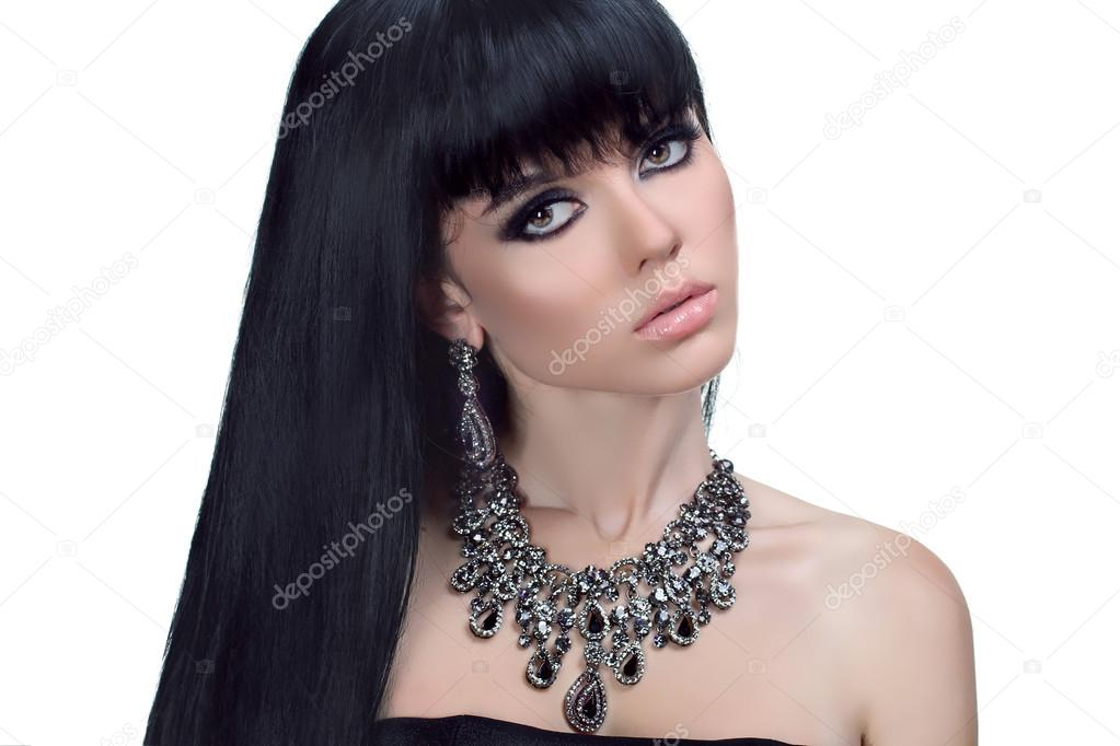 Glamour portrait of beautiful brunette woman with Healthy Long Hair. Fashion and Jewelry  — Stock Photo #15474817