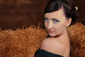 Beautiful Woman relaxing on natural background,wheat hay, studio — Stock Photo