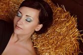 Close up make up of beautiful woman slipping on wheat hay — Stock Photo