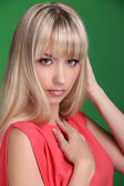 Portrait of beautiful female model on green background. Beautifu — Stock Photo