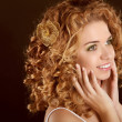 Curly Hair. Attractive smiling woman portrait on dark background — Stock Photo