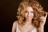 Attractive smiling teen girl with Curly Hair wavy hair, curl on — Stock Photo