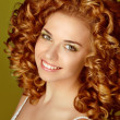 Curly Hair. Attractive smiling woman beauty portrait. Glossy hai - Stock fotografie