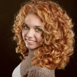 Healthy Curly Hair. Attractive smiling woman portrait on black b — Stock Photo #17690797