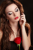 Elegant woman with red rose. Glamour portrait of female makeup — Stock Photo