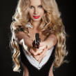 Royalty-Free Stock Photo: Sexy blond woman shooting gun isolated on black background