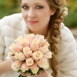 Royalty-Free Stock Photo: Beautiful bride woman portrait with bridal bouquet posing in her