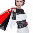 Photo of young elegant woman with shopping bags  isolated on whi — Stock Photo