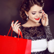 Closeup of a smiling beautiful young woman with shopping bag tal — Stock Photo