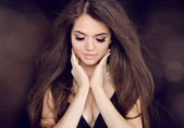 Beautiful woman with long brown hair. Fashion long hairstyles — Stock Photo
