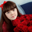 Portrait of attractive teen girl with red roses bouquet flowers — Stock Photo