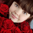 Portrait of attractive teen girl with red roses bouquet flowers — Stock Photo #21289645